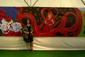 Nancy in front of the Evil Red Queen of Hearts