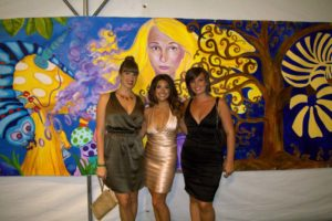Tracee Badway and Friends in front of the Green Tie Ball Mural