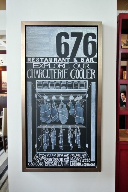 This board is in the dining room, showing their Charcuterie Cooler. 676 is one of the only restaurants in Chicago to cure their own meats.